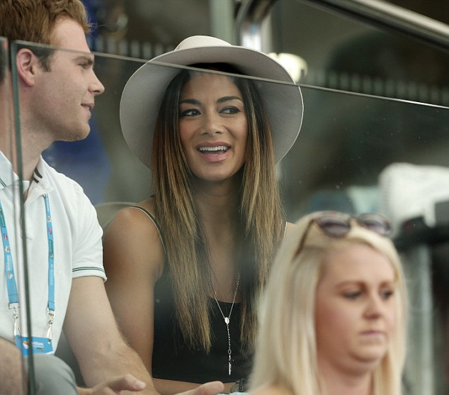 Pop star Nicole Scherzinger was spotted in the crowd watching her partner Grigor Dimitrov of Bulgaria during his match against France's Gilles Simon at the Brisbane International tennis tournament in Brisbane, 4 January 2015.